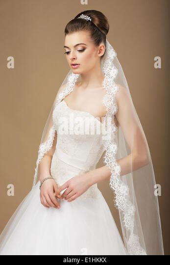 Young Romantic Newlywed with White Veil in Reverie - Stock Image