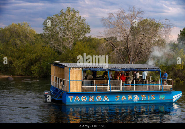 Cruise along the Victoria Falls aboard the ' African Queen'.  Other boats sailing in the Zambezi River. - Stock-Bilder