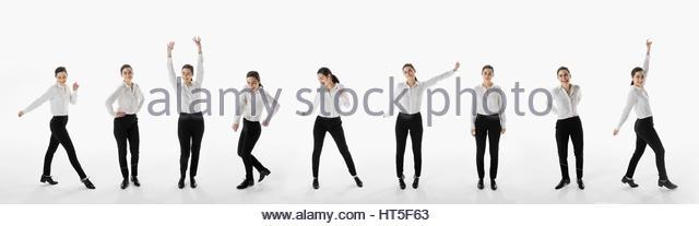 Sequence businesswoman dancing against white background - Stock-Bilder