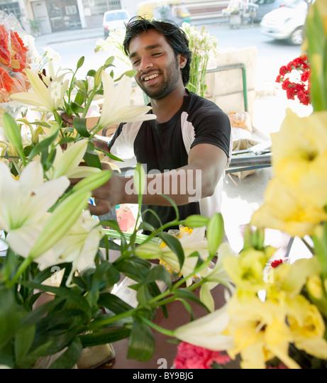 Florist arranging flowers - Stock-Bilder