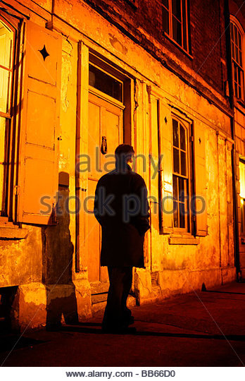 Man walking down the street at night remarkable