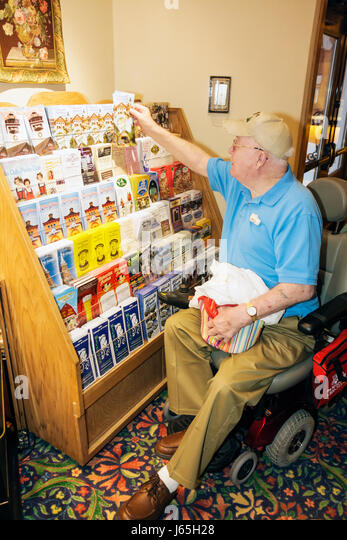 Michigan Frankenmuth Bavarian Inn Lodge hotel electric wheelchair lobby man disabled brochures kiosk information - Stock Image