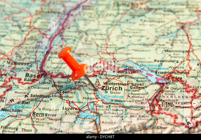 Red map pin pointing on map to the city of Zurich. - Stock Image