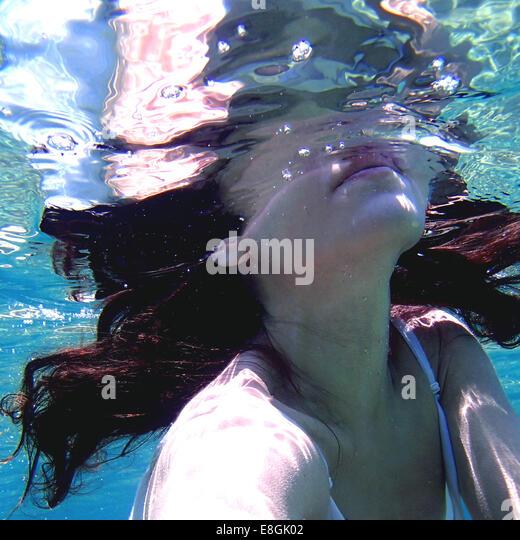 Greece, Attica Periphery, Lavreotiki, Souniou, Cape Sounio, Woman underwater - Stock Image