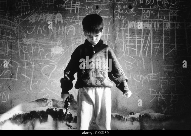'Rocky', A tense, hyperactive child who has a home but roams the streets of Sarajevo suffering from war - Stock Image