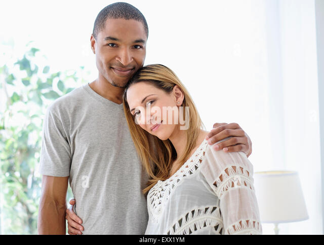 Mid adult couple embracing - Stock Image