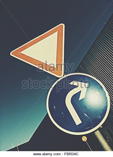 Low Angle View Of Arrow Sign - Stock-Bilder