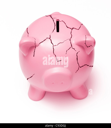 Cracked pink piggy bank on a white background signifying the poor state of the economy - Stock Image