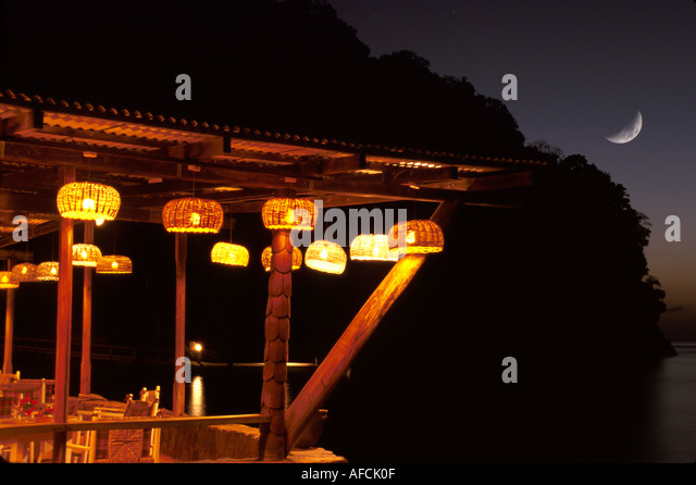 West Indies St. Lucia Anse Chastanet Resort Caribbean Sea Beach Restaurant bar hanging lanterns lights night moon - Stock Image