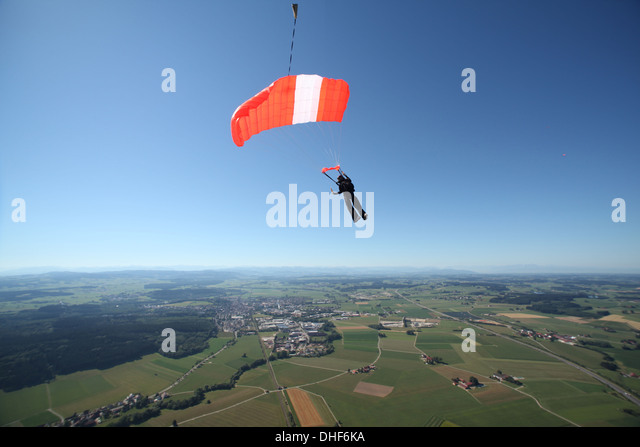 Skydiver parachuting down above Leutkirch, Bavaria, Germany - Stock Image