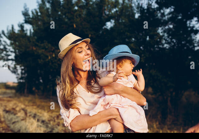mother and daughter together outdoors - Stock Image