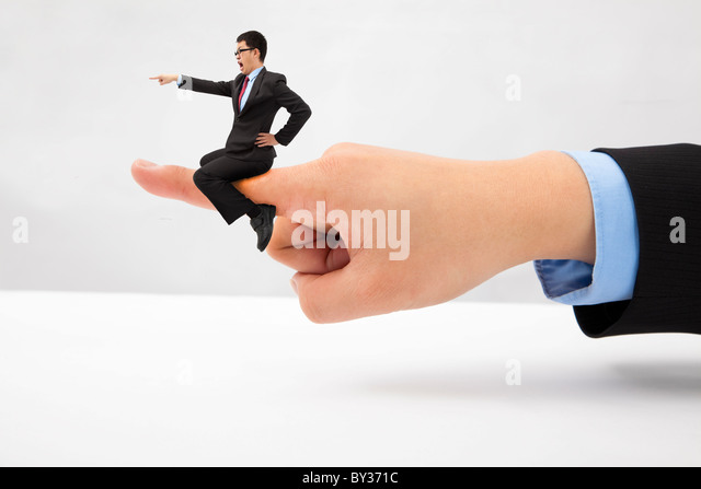 Business concept.Businessman sitting on the finger shouting and blaming - Stock Image