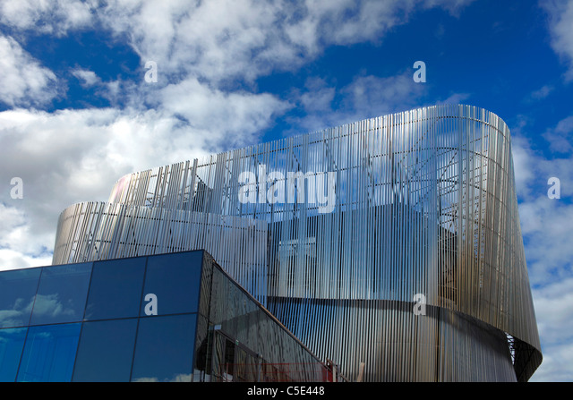 High section of futuristic metallic and glass buildings against blue sky and Stockholm - Stock Image