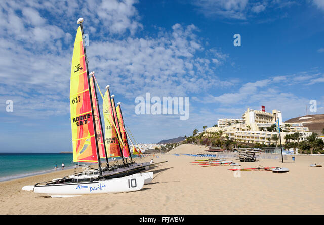 Hobie cats and wind surfers beached on the sand at Morro Jable, Fuerteventura, Canary Islands, Spain - Stock Image