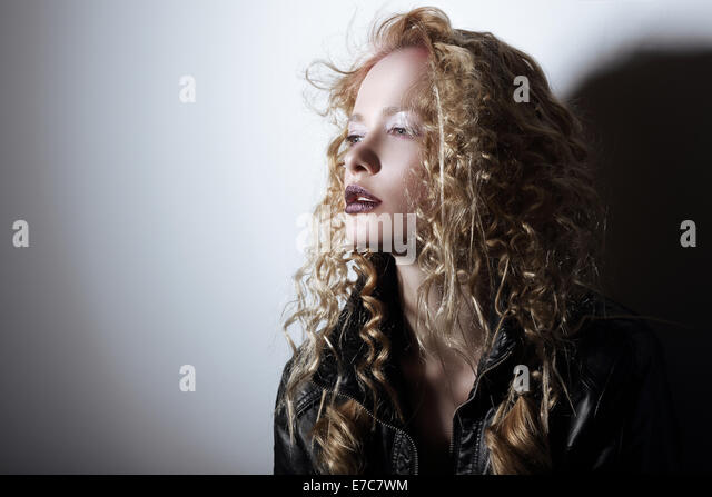 Portrait of Young Woman with Frizzy Hair - Stock Image