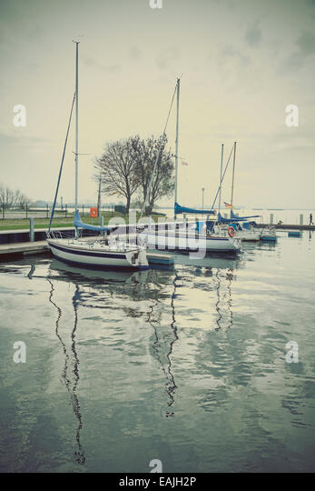 Marina with yachts at sunset, retro vintage effect. - Stock-Bilder