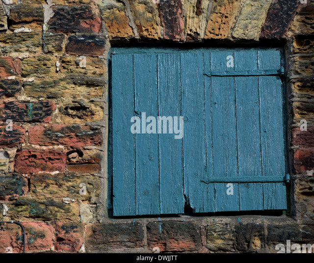 A Green wooden door - Stock Image