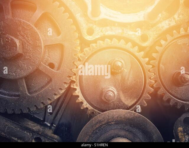 The together of rusty cogwheels background with sun-flare effect - Stock-Bilder
