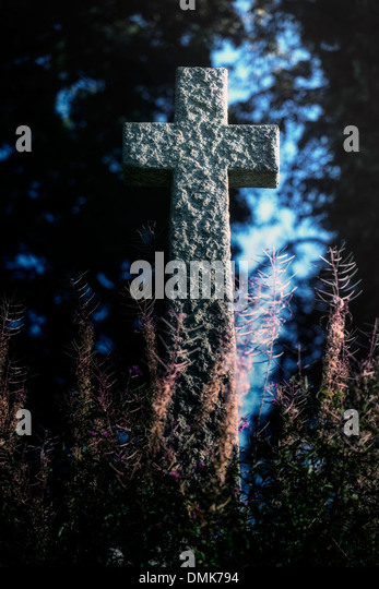 a cross on an old grave - Stock Image