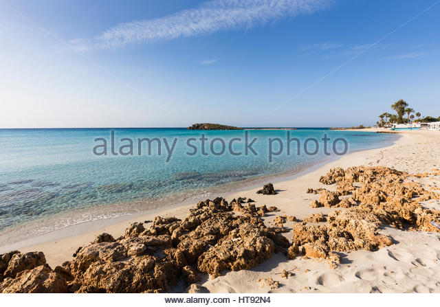 Mediterranean Sea with rock formations on Nissi Beach at the Nissi Beach Resort at Agia Napa in Cyprus - Stock Image