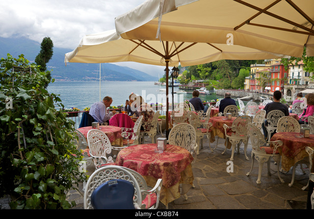 Lakeside view of cafe in the medieval village of Varenna, Lake Como, Lombardy, Italian Lakes, Italy, Europe - Stock Image