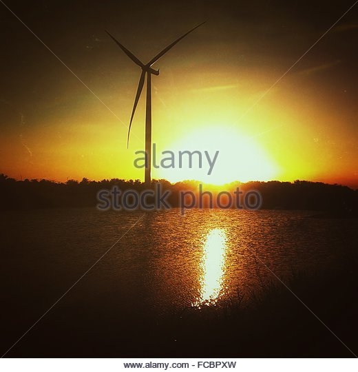 Lake And Wind Turbine At Sunset - Stock Image