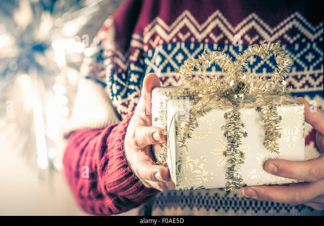 Person holding christmas gift - Stock Image