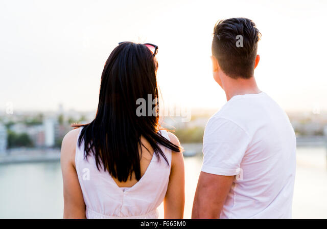 Happy couple in love smiling and being sensual - Stock Image