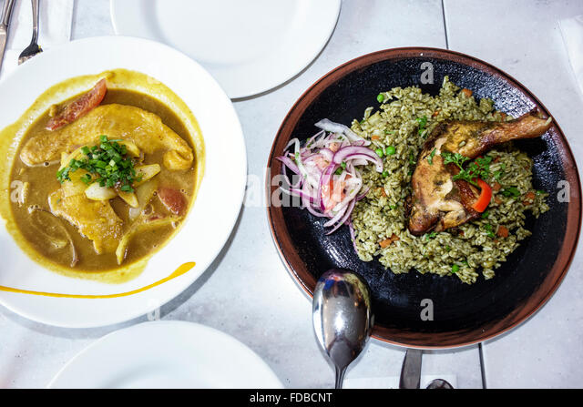 Miami Florida downtown Cvi.che 105 Peruvian restaurant plates lunch food fish roasted chicken cilantro rice - Stock Image