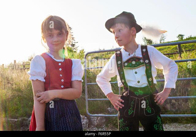 Portrait of boy and girl in traditional Bavarian costume - Stock-Bilder