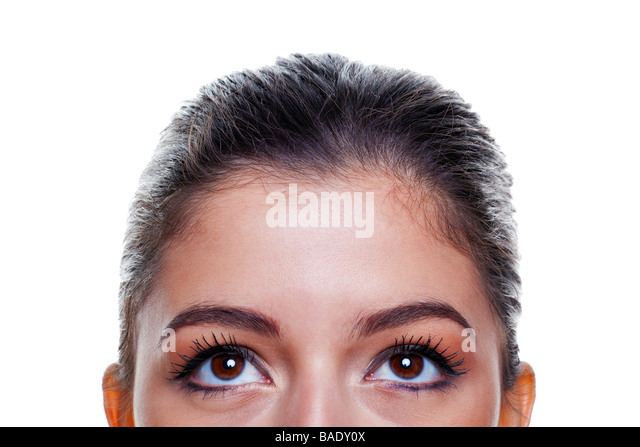 Beautiful brunette woman with big brown eyes looking upwards isolated on white background - Stock Image