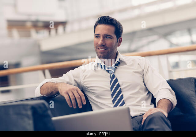 Portrait of a businessman relaxing - Stock-Bilder