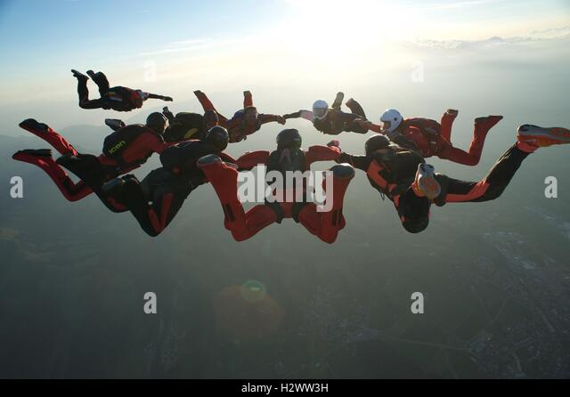 Skydiver number nine closing in on a star formation - Stock Image