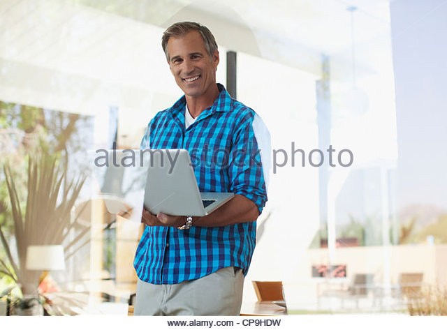 50-54 years,accessibility,california,carrying,casual clothing,caucasian,color image,connection,convenience,copy - Stock Image