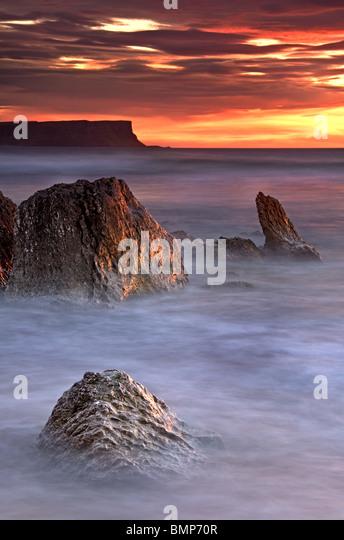 Whitepark Bay sunset, Antrim coast, Northern Ireland. - Stock Image