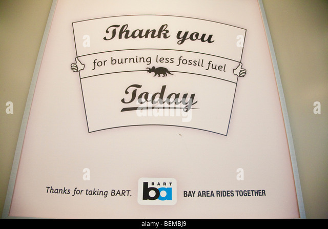 A BART (Bay Area Rapid Transit) advertising sign reading 'Thank You for Burning Less Fossil Fuels Today' - Stock Image
