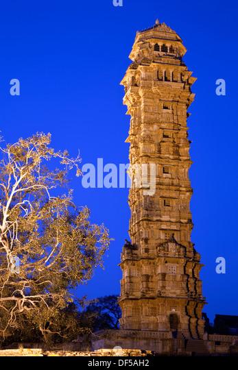 Jaya Stambha (Tower of Victory) at dusk. Chittorgarh Fort. Rajasthan. India - Stock Image