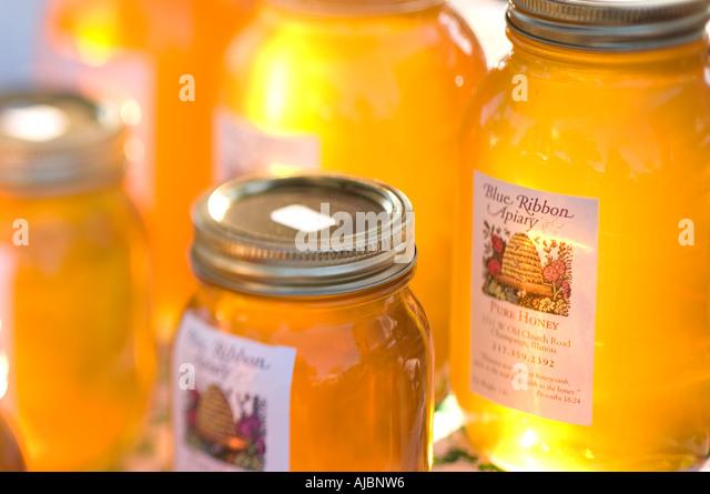 Jars of Honey at the Farmers Market - Stock Image