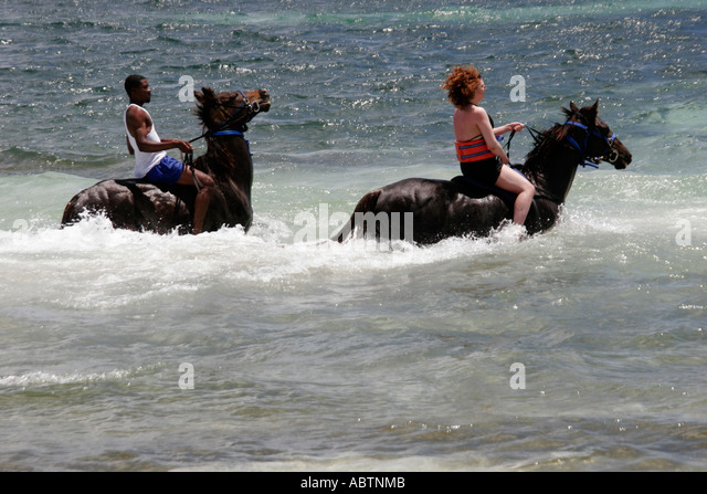 Grand Turk Atlantic Ocean Indigenous Horse Shelter horseback riding surf - Stock Image