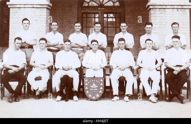Group photo, No. 4 Mountain Battery Royal Garrison Artillery cricket team with sub-section shield and dog mascot, - Stock Image