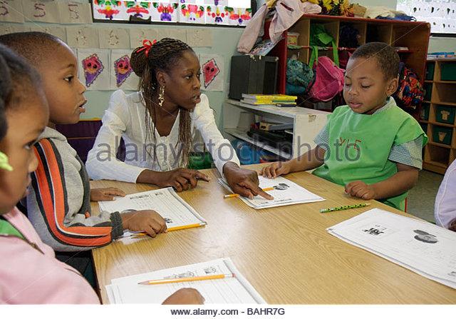 Miami Florida Little Haiti Yvonne Learning Center private Christian school education class student Black woman boy - Stock Image