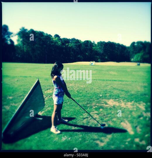 Little girl golfer - Stock Image