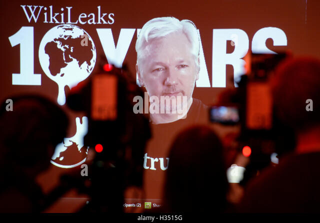 Berlin, Germany. 4th Oct, 2016. Wikileaks founder Julian Assange in a live video link speaking at a press conference - Stock Image