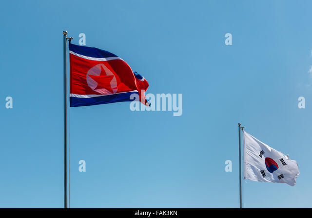 North and South Korean flags, North Korea, South Korea, flags waving in the wind, blue sky - Stock Image