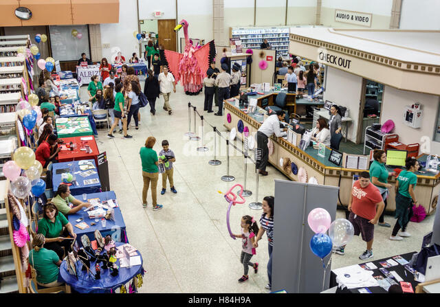 Miami Florida Hialeah JFK Library Health and Literacy Fair interior exhibitors tables - Stock Image
