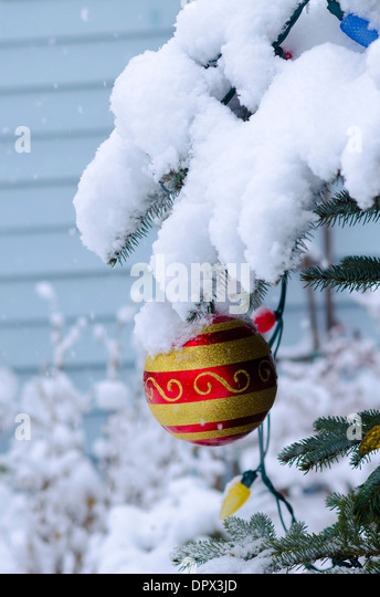 Christmas ornament snow snowing - Stock Image