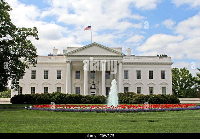 The White House in Washington DC in spring with fountain and red tulips. - Stock Image