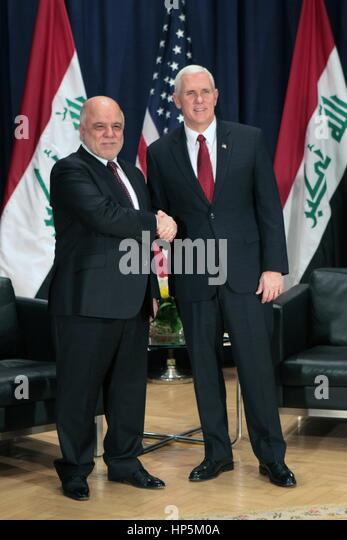 Munich, Germany. 18th Feb, 2017. U.S. Vice President Mike Pence greets Iraqi Prime Minister Haider al-Abadi on the - Stock Image