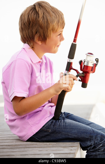 Young boy with fishing rod - Stock Image
