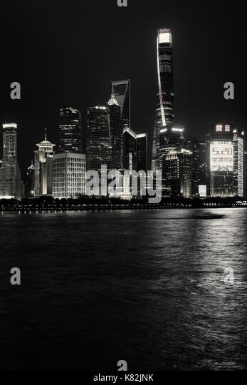 Skyline of the Pudong District in Shanghai, China, viewed from the Bund across the Huangpu River - Stock Image